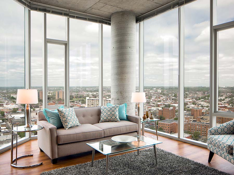 Korman apartment with floor to ceiling windows showing the city outside