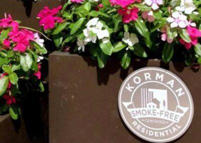 Flower pot with Korman Smoke Free plaque