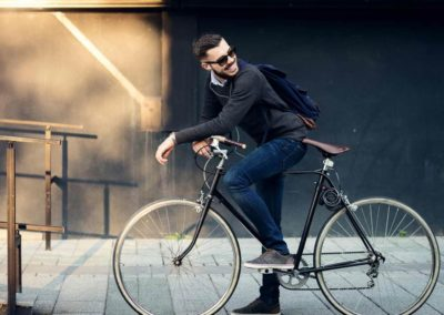 Young professional riding a bike in the city